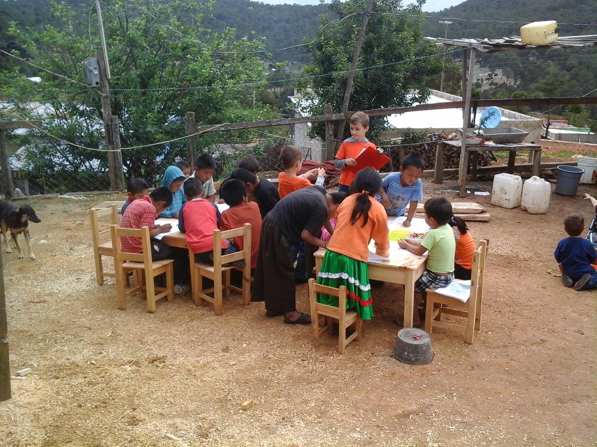 Caleb (age 9) teaching Sunday School in village